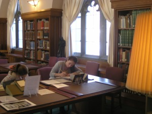 "Students from Professor Stacey Barone's Spring 2010 ""Introduction to Professional Nursing"" class examine letters written by Florence Nightingale as part of an extra credit assignment."