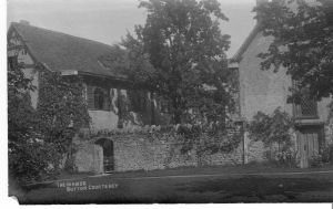 One of the postcards sent by Lindsay to Belloc, featuring a photo of Norah Lindsay's home, Sutton Courtenay, from the Hilaire Belloc Papers, MS2005-02, John J. Burns Library, Boston College.