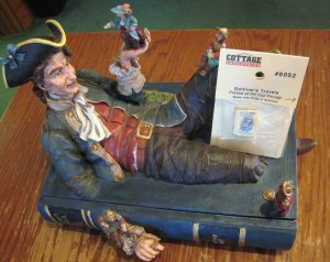 Pictured here are two items from the William F. Cunningham, Jr. Collection of Jonathan Swift Materials:  a curio box showing Gulliver with the Lilliputians and (resting against Gulliver's knee) a miniature edition of Gulliver's Travels.
