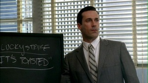 Don Draper from AMC's Mad Men inventing the Lucky Strike Slogan.