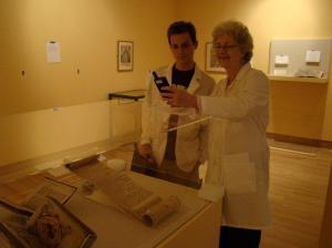 Burns Conservator Barbara Adams Hebard and Burns Conservation Assistant Robert Williams check light levels on a revision copy of the Magna Carta issued by Henry III in 1225, now on display as part of the Making History exhibit at the McMullen Museum.