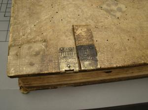 In this photo, observe the matching detail between the clasp and its corresponding piece on the binding!