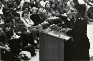 Photograph of Maya Angelou reading at Robsham Theater, Box 60, Folder 5, Francis W. Sweeney, SJ, Humanities Series Director's Records, MS2002-37, John J. Burns Library, Boston College.