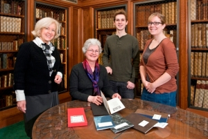 Precious Poems exhibit organizers, from left: Irish Studies Librarian Kathleen Williams, Conservator Barbara Adams Hebard, Robert Williams '14; graduate student Carolyn Twomey. Photo by Gary Wayne Gilbert.