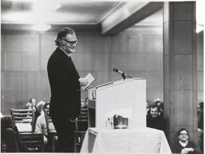 Photograph of Robert Lowell speaking in Lyons Hall, Welch Dining Room, December 3, 1969, Box 62, Folder 51, Francis W. Sweeney, SJ, Humanities Series Director's Records, MS2002-37, John J. Burns Library, Boston College.
