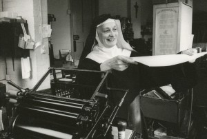 Sister Hildelith Cumming  in the Stanbrook Abbey pressing room, 1976. Stanbrook Abbey Press collection. MS 2003.020, John J. Burns Library, Boston College.