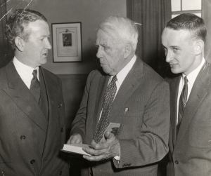 Photograph of celebrated American poet Robert Frost (1874-1963) with Gerard Woods and Edward Thomas at reception, Box 61, Folder 22, Francis W. Sweeney, SJ, Humanities Series Director's Records, MS2002-37, John J. Burns Library, Boston College.