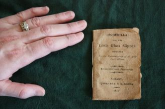 "This image captures the small scale of the 1814 copy of Perrault's ""Cinderilla, or the Little Glass Slipper."""