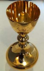 "Chalice, inscription on the bottom reads, ""REV. DANIEL LINEHAN S.J. 1ST MASS AT SOUTH POLE 1958 1ST MASS AT NORTH MAGNETIC POLE 1954 REST OF WORLD ST PETER'S TOMB 1952,"" Father Daniel Linehan Papers, John J. Burns Library, Boston College."