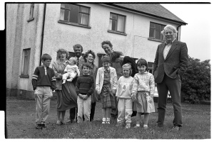 Seamus Heaney with his two brothers, wife and children at Bellaghy, early 1980s.  Bobbie Hanvey, photographer, image bh002795, Bobbie Hanvey Photographic Archives, John J. Burns Library, Boston College.  This image is part of a series found at:  hdl.handle.net/2345/931.