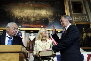 U.S. Sen. Edward J. Markey, D-Mass., raises his hand during a ceremonial swearing-in at historic Faneuil Hall, Thursday, Aug. 8, 2013, in Boston. Markey was officially sworn in last month by Vice President Joe Biden during a brief ceremony in the Senate chamber in Washington. At center is Markey's wife, Susan Blumenthal. At left, administering the oath of office, is Boston Mayor Thomas Menino. (AP Photo/Charles Krupa)