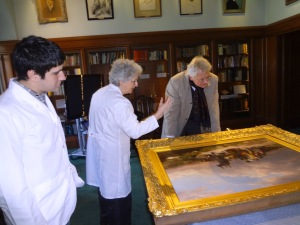 Mr. Rainbird, Director of the National Gallery or Ireland, and Burns Conservator Barbara Adams Hebard inspect the Kelly painting as I stand by.   Photo by Anthony Mourek.