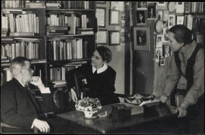 Joyce talking with publishers Sylvia Beach and Adrienne Monnier at Shakespeare & Co., Paris, 1920, image from the Beinecke Rare Book & Manuscript Library, Yale University.