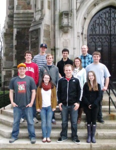 """Professor Sylvia Sellers-Garcia and her Spring 2014 """"Making History Public"""" students pictured in front of the Burns Library's Ford Tower."""