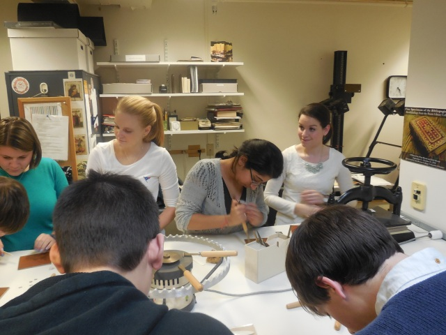 """Early Printed Books: History and Craft"" students working in the Burns Conservation lab."