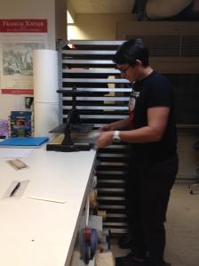 Mason Bratberg '17 using a nipping press.  Photograph by Associate Professor Karen Miller.