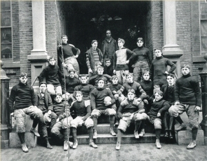 The 1897 football squad crowds onto the steps on the James Street campus