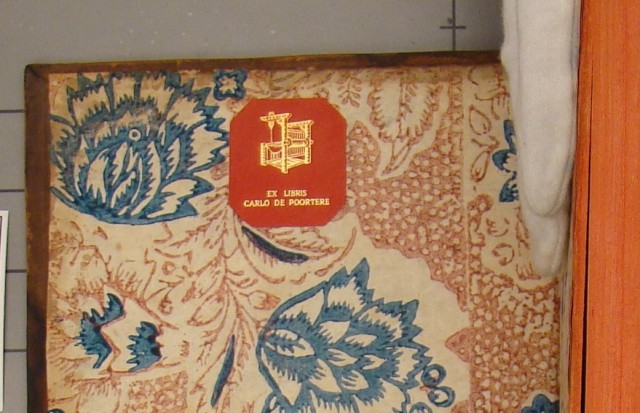 Photo of Carlo de Poortere's red leather bookplate.