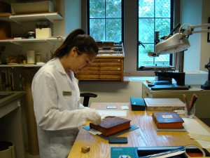 photograph of conservation intern working at bench