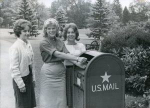 Photograph of students at a mailbox