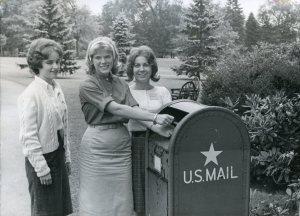 Photograph of students at a mailbox