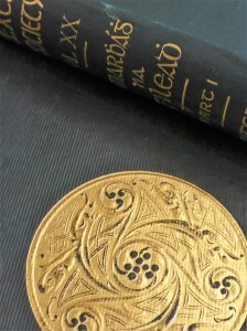 Photograph of book binding with gold Celtic medallion