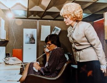 Photograph of Heckler visiting the HHS AIDS Hotline center, 1983.