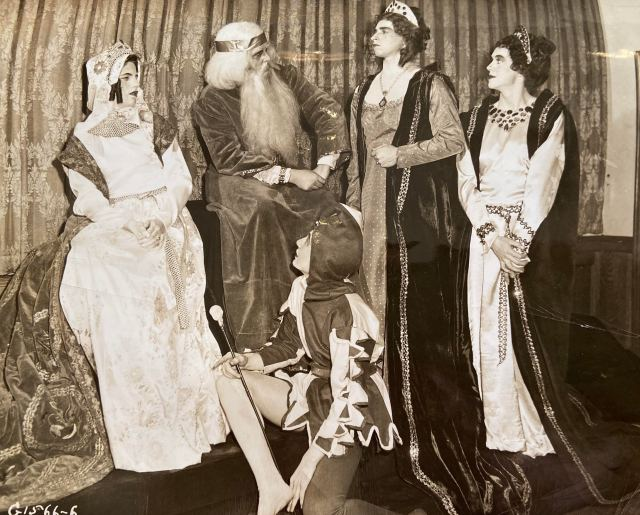 Five actors in costume, including King Lear, Cordelia, Regan, and Goneril, and the Fool