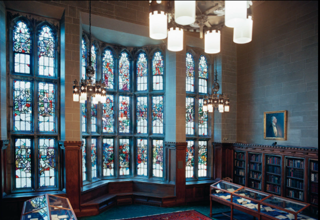 photograph of stained glass windows in the Thompson Room, Burns Library