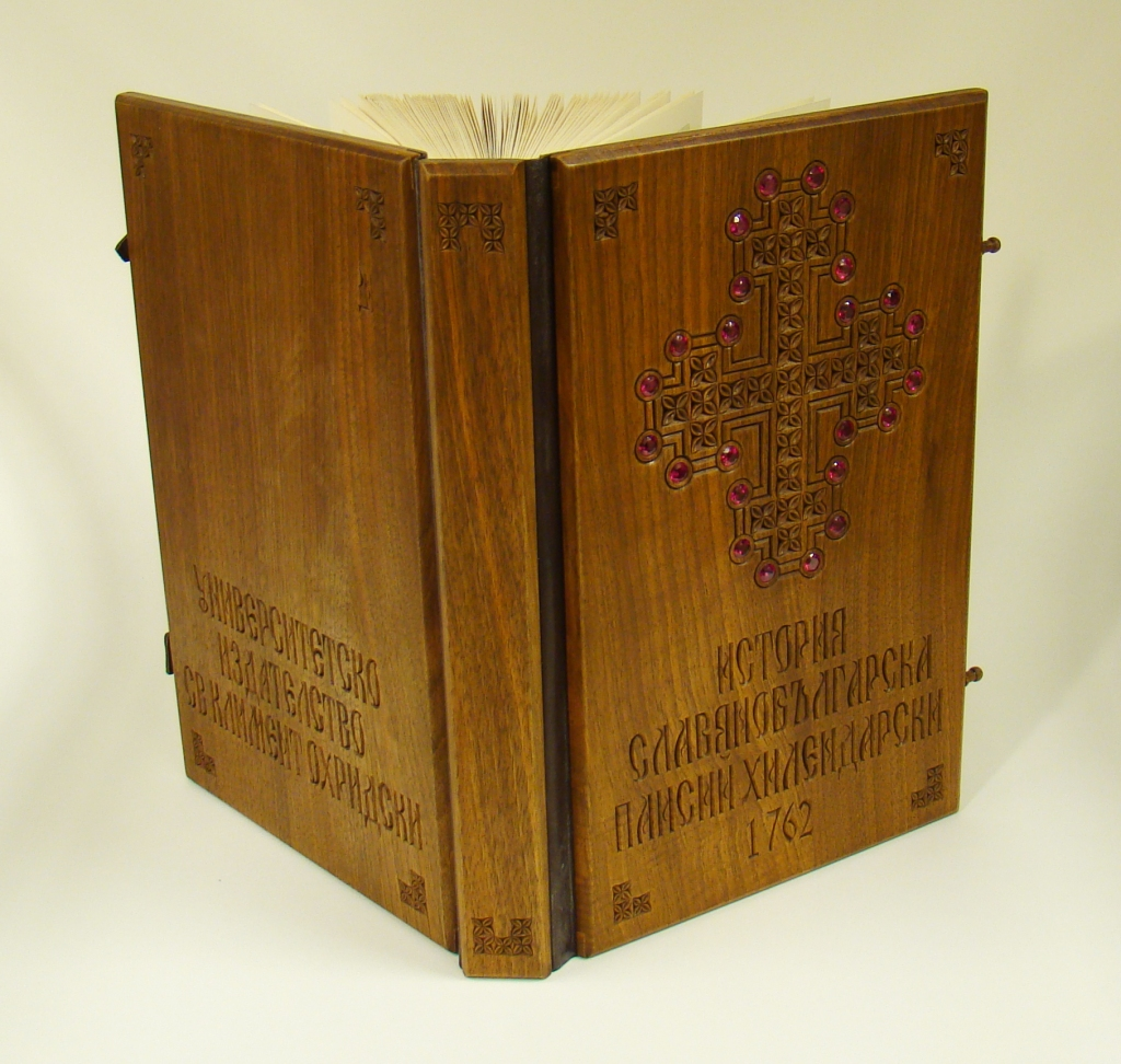 Book opened to display carved wooden cover