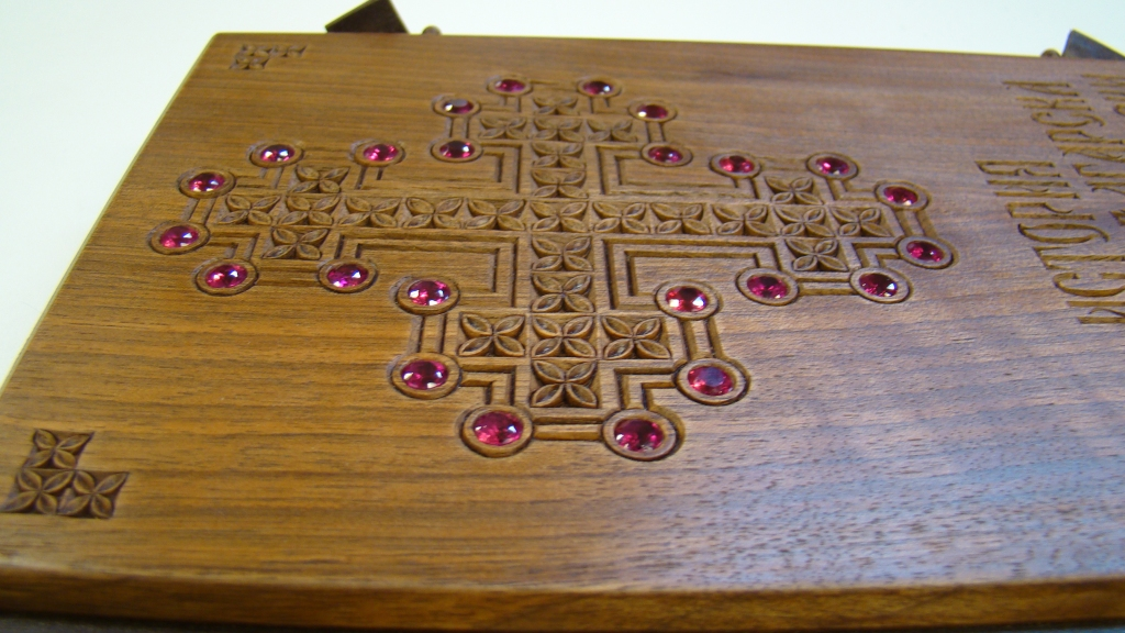 Red garnets on a wooden book cover