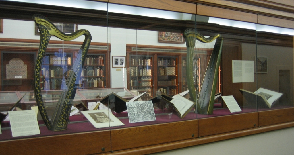 Display case showing two large harps side by side