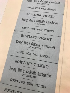 several printed tickets, each good for one string of bowling